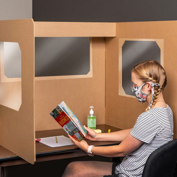girl with mask on reading at a desk with the Ecorr Desk Divider® corrugated desk divider with windows in the sides and plastic shields to protect students in classrooms